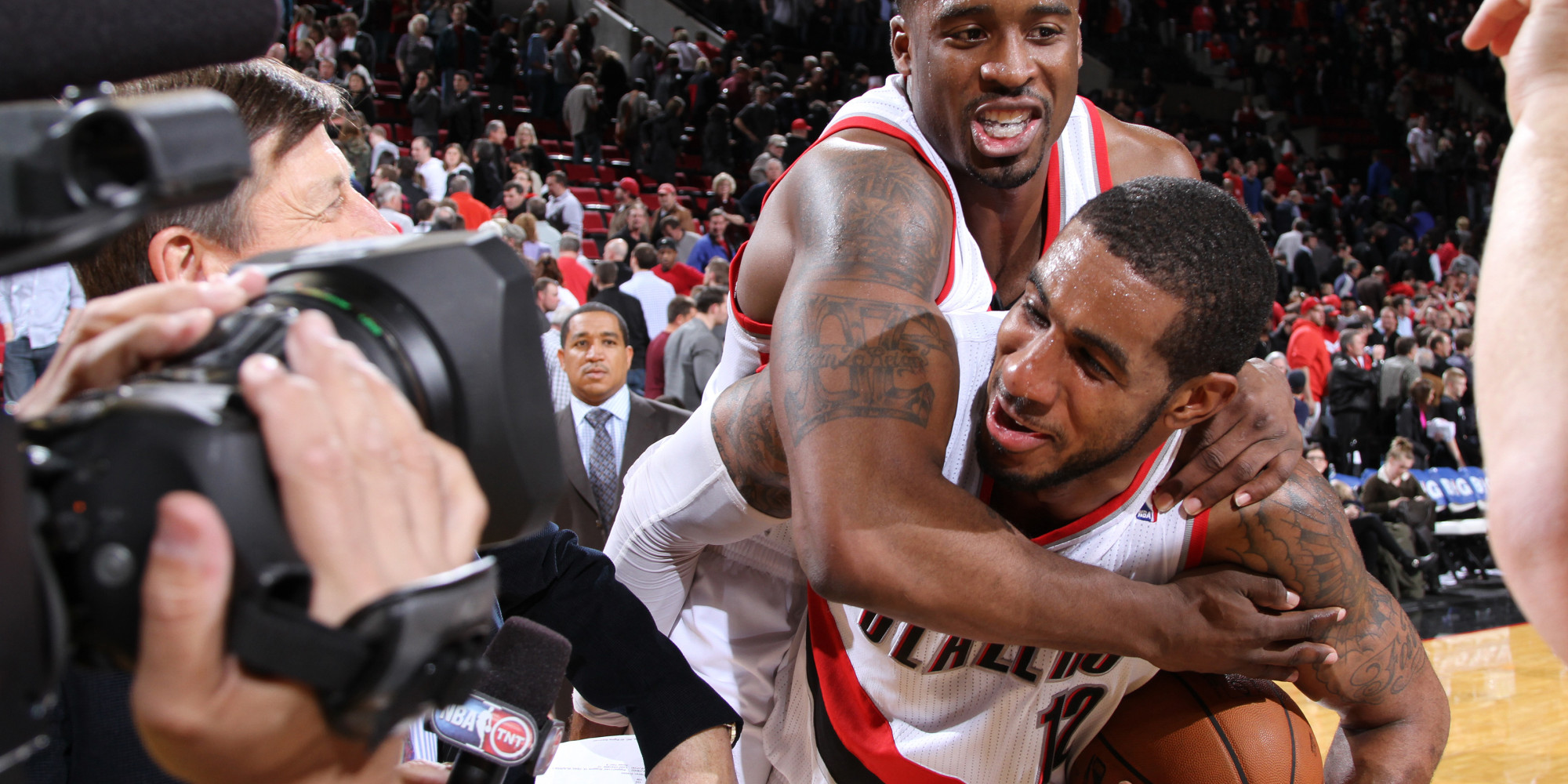 PORTLAND, OR - JANUARY 23:  LaMarcus Aldridge #12 and Wesley Matthews #2 of the Portland Trail Blazers celebrate after the game against the Denver Nuggets on January 23, 2014 at the Moda Center Arena in Portland, Oregon. NOTE TO USER: User expressly acknowledges and agrees that, by downloading and or using this photograph, user is consenting to the terms and conditions of the Getty Images License Agreement. Mandatory Copyright Notice: Copyright 2014 NBAE (Photo by Sam Forencich/NBAE via Getty Images)