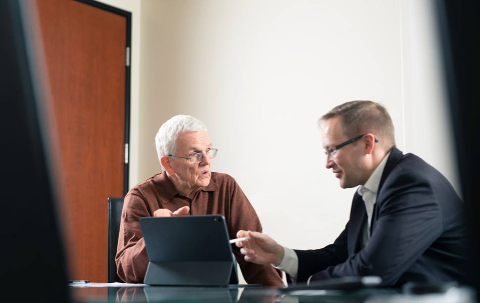 Two people discussing finance strategies